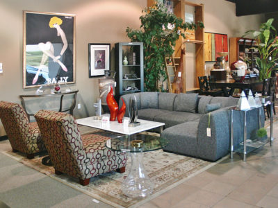Gray Sectional with Patterned Slipper Chairs and Marble Coffee Table