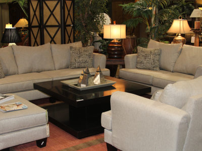 Living Room Set with Beige Couch Loveseat Arm Chair and Ottoman Around a Square Black Coffee Table
