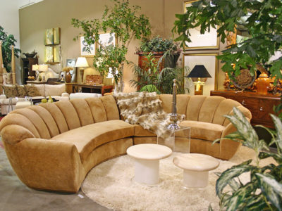 Tan Half Circle Couch with Fir Throw