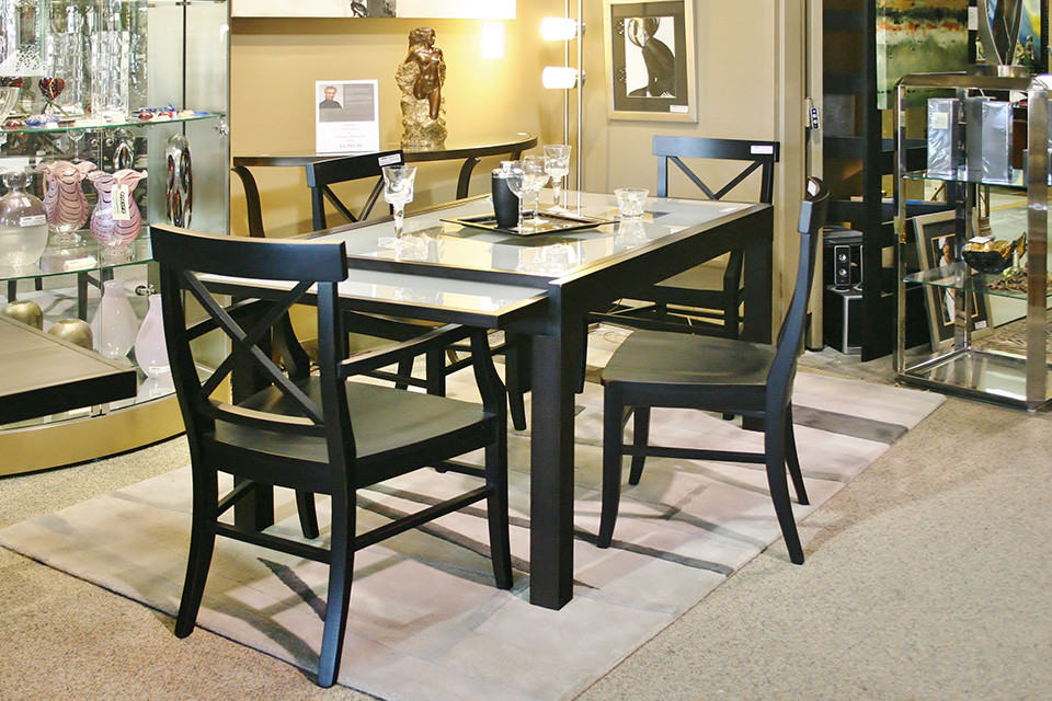 Set of 4 Black Wooden Dining Chairs Around a Black and White Dining Table
