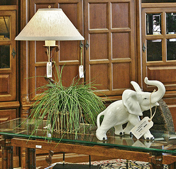 Glass Table with White Elephant Figurine and Plant